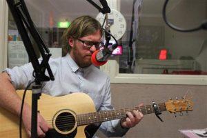 Dan Rolls with acoustic guitar
